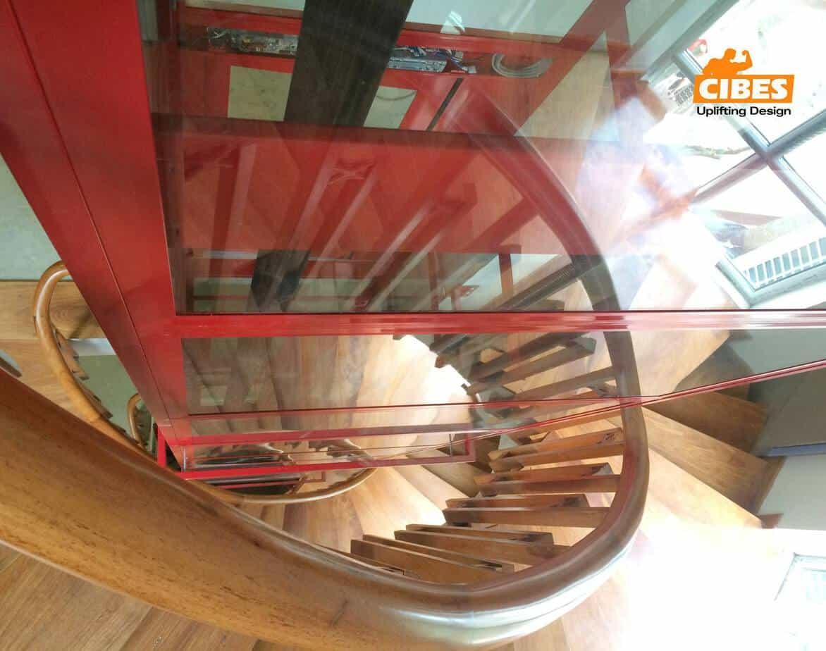 Giải pháp thiết kế thang bộ ôm thang máy trong gi...